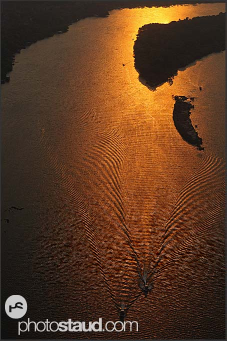Aerial photograph of two ships on the Zambezi River at sunset, Zambia
