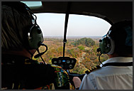 Inside a helicopter flying above Zambia
