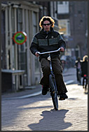 Cyclist in the streets of, Amsterdam, Holland, The Netherlands, Europe