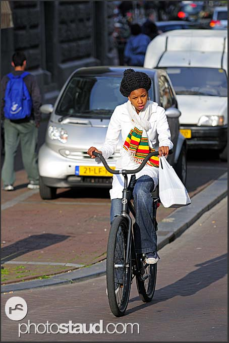 Cyclist in the streets of Amsterdam, Holland, The Netherlands, Europe