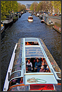 A tour boat on a canal, Amsterdam, Holland, The Netherlands, Europe