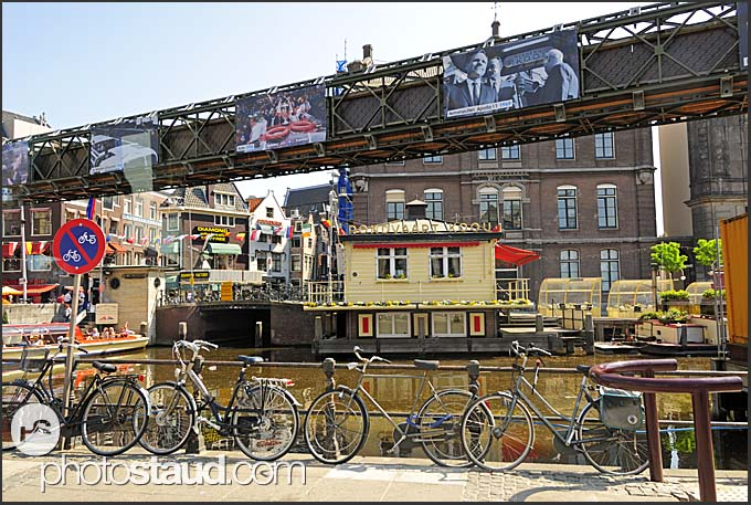 Bicycles on a bridge over the canal in Amsterdam, Holland, The Netherlands, Europe