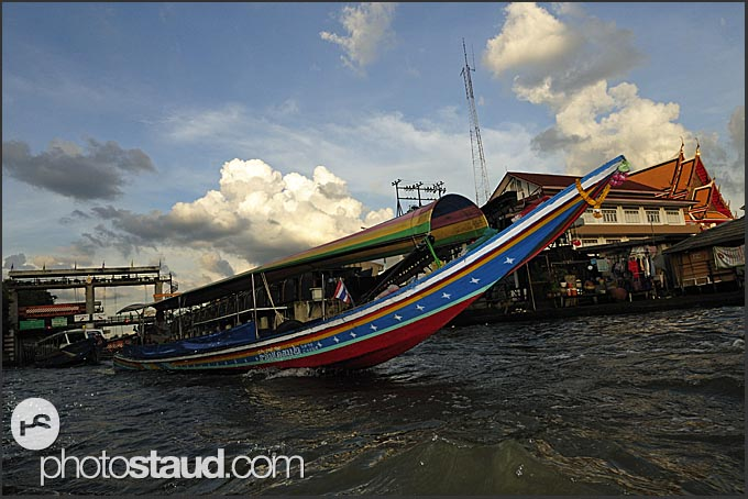 Long tail boat cruising the Chao Phraya River, Bangkok, Thailand