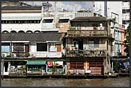 Shabby houses of corrugated iron along the Chao Phraya River, Bangkok, Thailand