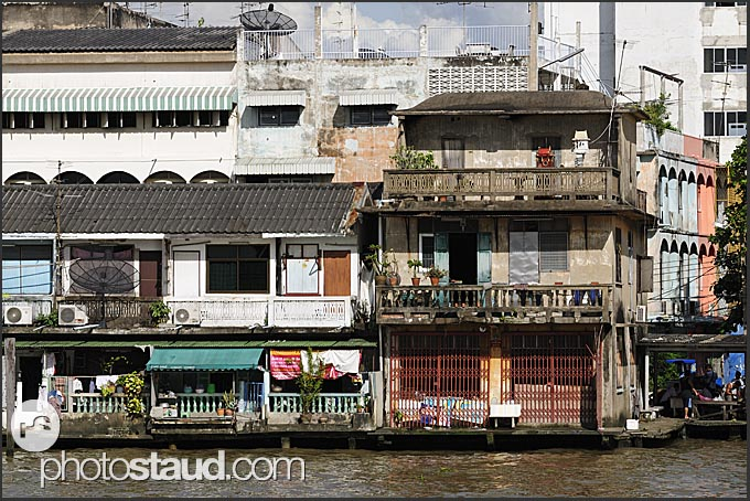 Old houses along the Chao Phraya River, Bangkok, Thailand