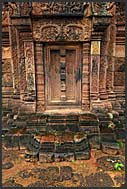 Elaborate relief carvings in walls and doors of Banteay Srei Temple, Citadel of women, Angkor, Cambodia