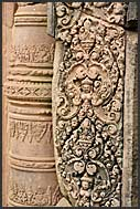 Detail of complicated carvings on red sandstone, Banteay Srei Temple, Angkor, Cambodia