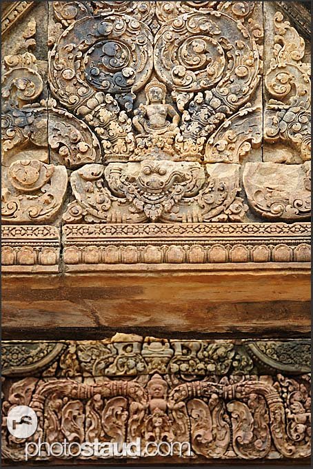Detailed carvings in red sandstone lintel, Banteay Srei Temple, Angkor, Cambodia
