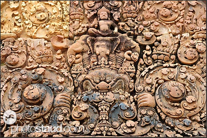 Intricate carvings in red sandstone lintel, Banteay Srei Temple, Angkor, Cambodia