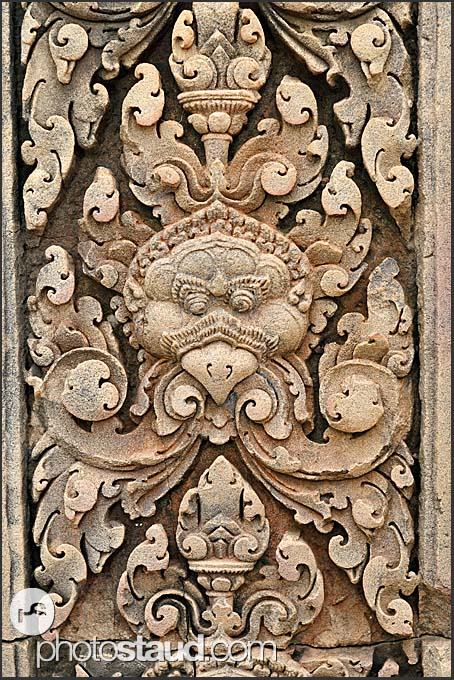 Detailed carvings adorn red sandstone lintel, Banteay Srei Temple, Angkor, Cambodia