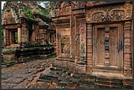 Intricate carvings adorn red sandstone in Banteay Srei Temple, Angkor, Cambodia