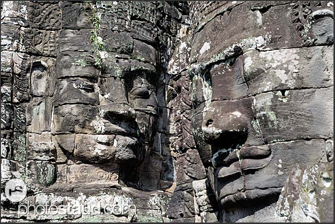 Giant carved stone faces of Lokeshvara at Bayon Temple of Angkor Thom, Cambodia