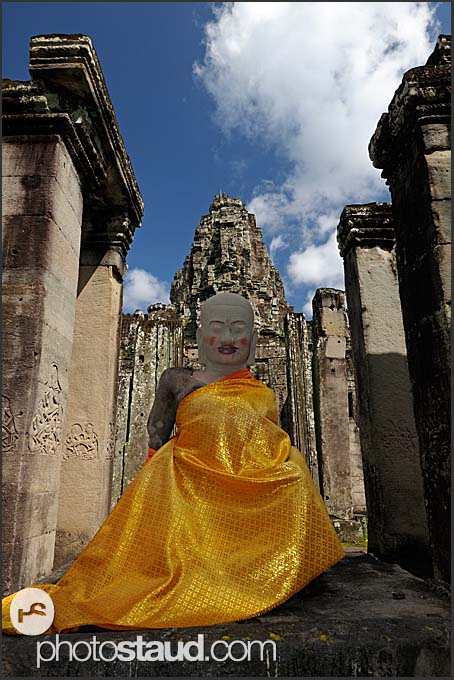 Buddhist stone statue in orange robe, Bayon Temple, Angkor Thom, Cambodia