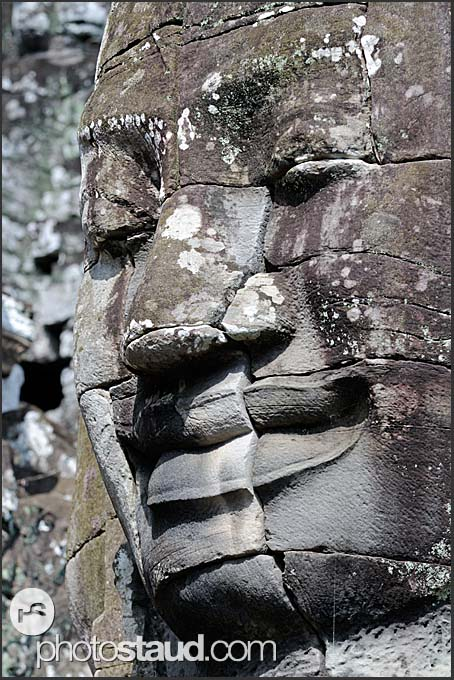 Smiling giant stone face of Lokeshvara, Bayon Temple of Angkor Thom, Cambodia
