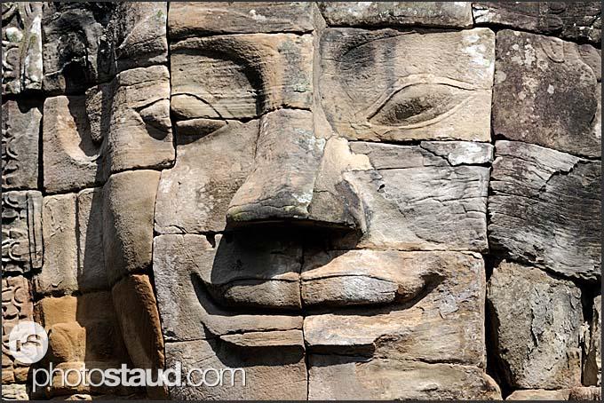 Smiling stone face of Lokeshvara, Bayon Temple, Angkor Thom, Cambodia