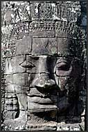Giant carved stone face of Lokeshvara, Bayon Temple, Angkor Thom, Cambodia