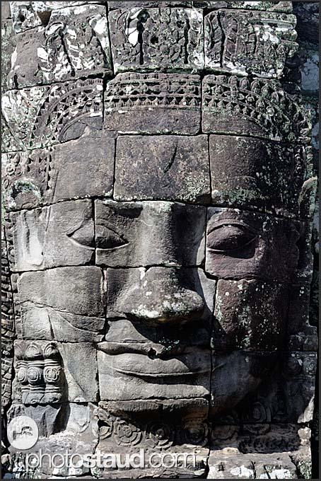 Giant carved stone face of Lokeshvara, Bayon Temple, Angkor Thom, Cambodia