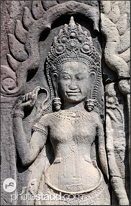 Stone carvings in the walls of bayon temple angkor thom
