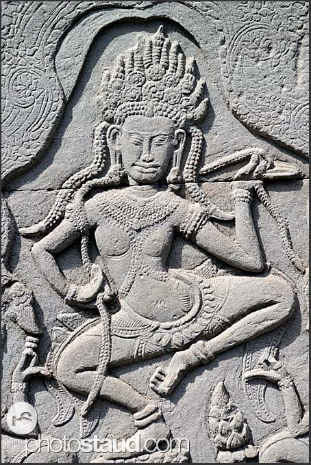Stone carvings in the walls of Bayon Temple, Angkor Thom, Cambodia