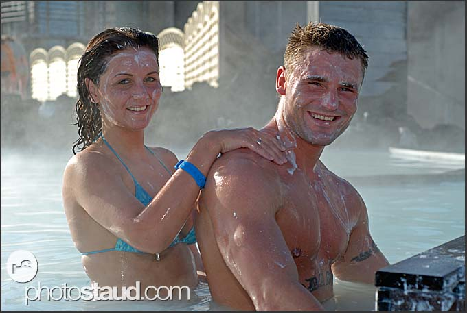 Young Icelandic girl massaging her boyfriend with Blue Lagoon mud, Iceland