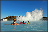 Icelanders enjoying sunny day in Blue Lagoon, Iceland