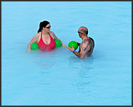 Man, woman and green balls in Blue Lagoon, Iceland