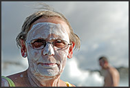 Elderly woman with skin healing mud on her face, Blue Lagoon, Iceland