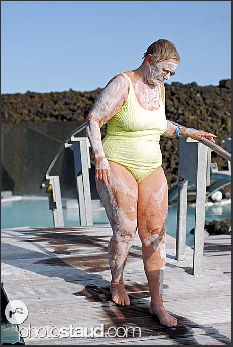 Elderly woman with skin healing mud on her body, Blue Lagoon, Iceland