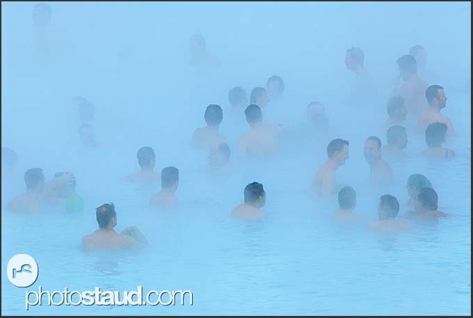 Crowds of tourists in the fog of Blue Lagoon, Iceland