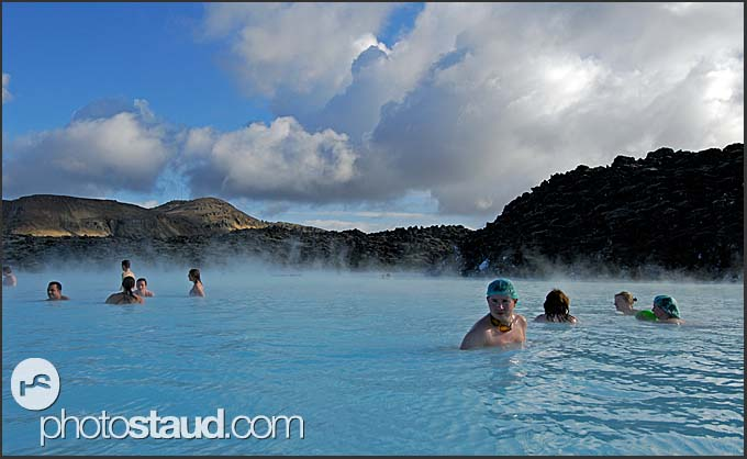 People enjoying sunny day in Blue Lagoon, Iceland
