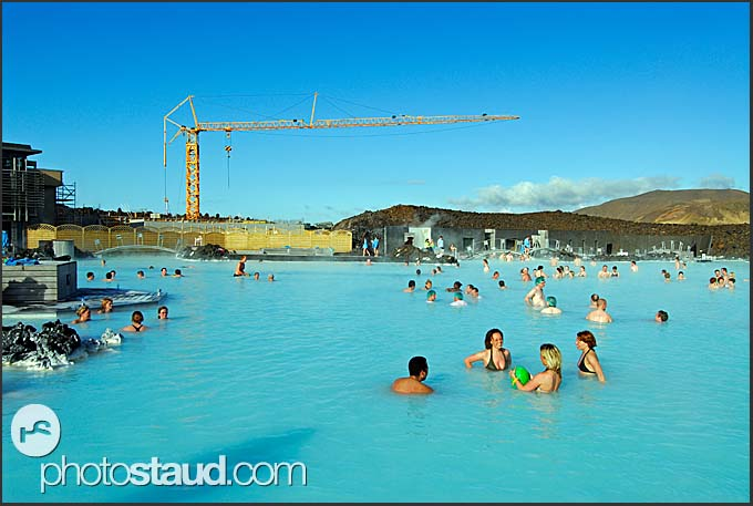 Construction cranes enlarging and redesigning Blue Lagoon, Iceland