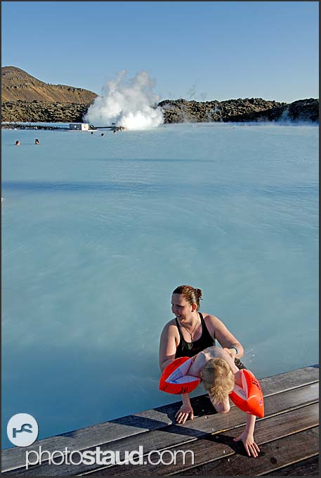 Mum and child enjoying sunny day in Blue Lagoon, Iceland