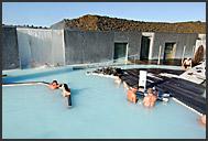 Icelandic couple enjoying sunny day in Blue Lagoon, Iceland