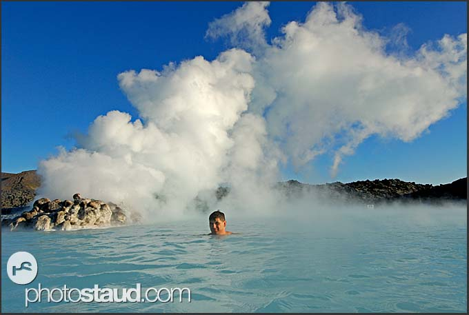 Man swimming in the waters of Blue Lagoon, Iceland