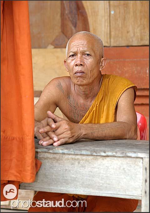 Buddhist monk in orange robes, Angkor, Cambodia
