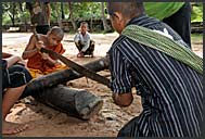 Buddhist monks making wood in Bakong monastery, Angkor, Cambodia