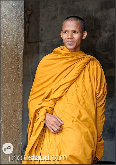 0313cea66d Buddhist monk standing in Angkor Wat