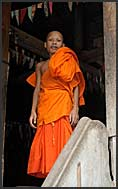 Tattooed Buddhist monk in Bakong Temple, Angkor, Cambodia