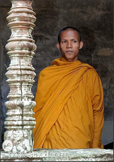 Monk and stone column, Angkor Wat, Cambodia