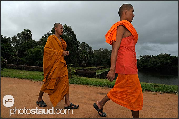 Buddhist monks walking on the grounds Bakong Temple, Angkor, Cambodia