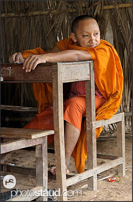Buddhist monk sitting in school, Bakong monastery, Angkor, Cambodia