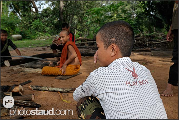 Buddhist monk trainee in a playboy shirt, Bakong monastery, Angkor, Cambodia