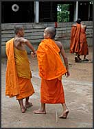 Novice Buddhist monks cutting woods, Bakong monastery, Angkor, Cambodia
