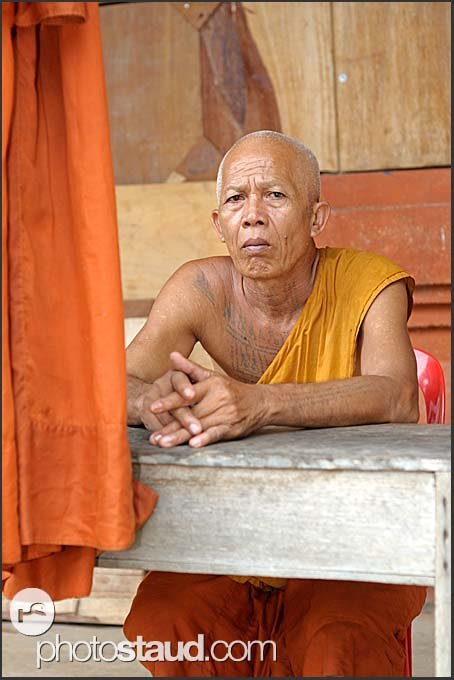 Buddhist monk with tattoos on his chest, Bakong Temple, Angkor, Cambodia