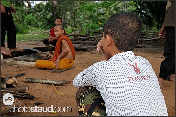 Buddhist monk trainee in a playboy shirt, Bakong monastery, Angkor, Cambodia