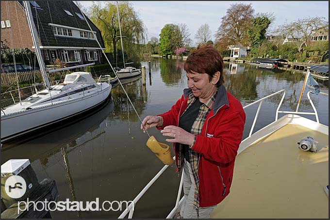 Paying toll to the wooden clog while passing a bridge, Holland, Europe