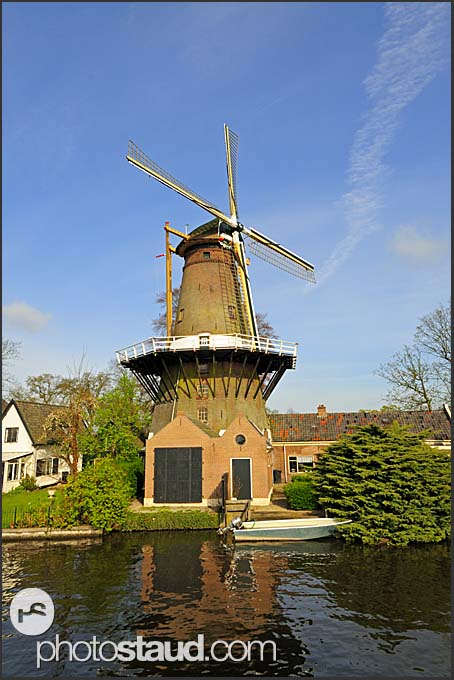 Traditional Dutch windmill at canal, Holland, Europe