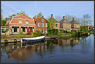 Houseboat reflecting in the waves of Dutch canal, Holland, Europe