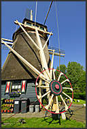 Traditional Dutch windmills along canals, Holland, Europe