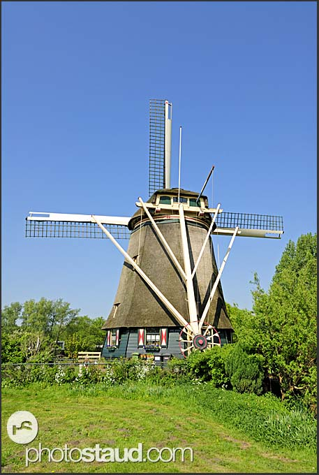 Traditional Dutch windmills along water-canals, Holland, Europe